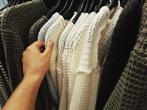 Cropped Hand Of Man Choosing Clothes From Rack - gettyimageskorea