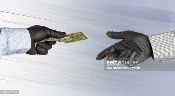 Cropped Hand Of Man Giving Money To Friend