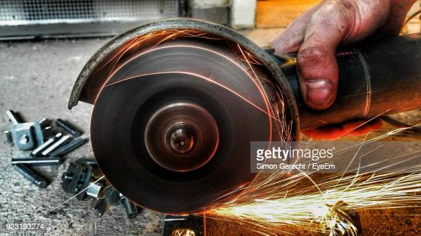 Cropped Hand Of Man Grinding Metal