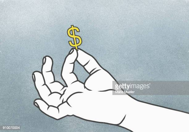 cropped hand of man holding dollar sign against gray background - making money stock pictures, royalty-free photos & images