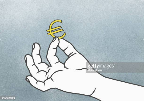 Cropped hand of man holding Euro symbol against gray background