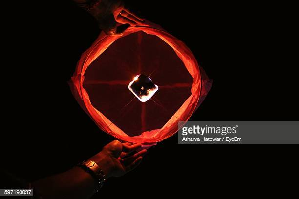 Cropped Hand Of Man Holding Illuminated Diwali Lantern