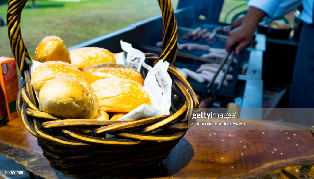 Cropped Hand Of Man Making Food On Barbecue Grill : Stock Photo