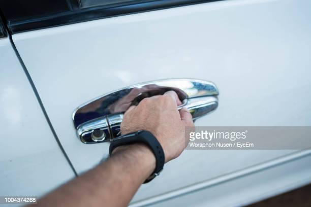 Cropped Hand Of Man Opening Car Door