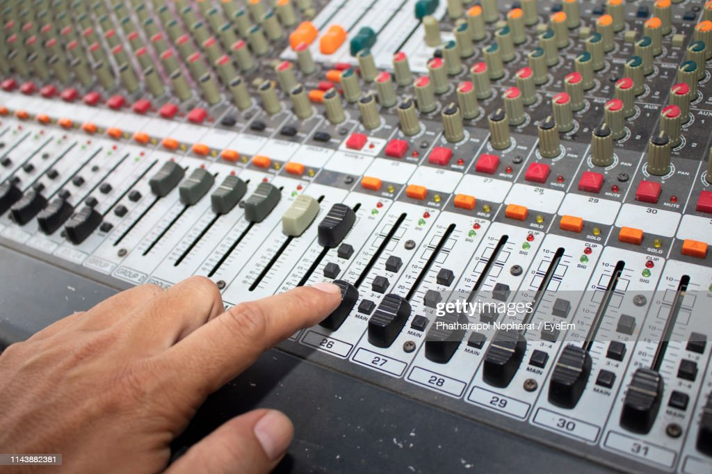 Cropped Hand Of Man Using Sound Mixer : Stock Photo