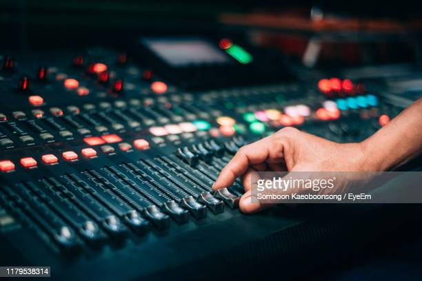 cropped hand of man using sound recording equipment - equaliser stock pictures, royalty-free photos & images