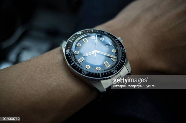 Cropped Hand Of Man Wearing Watch