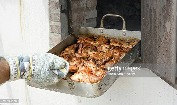 Cropped Hand Of Man With Rabbit Meat