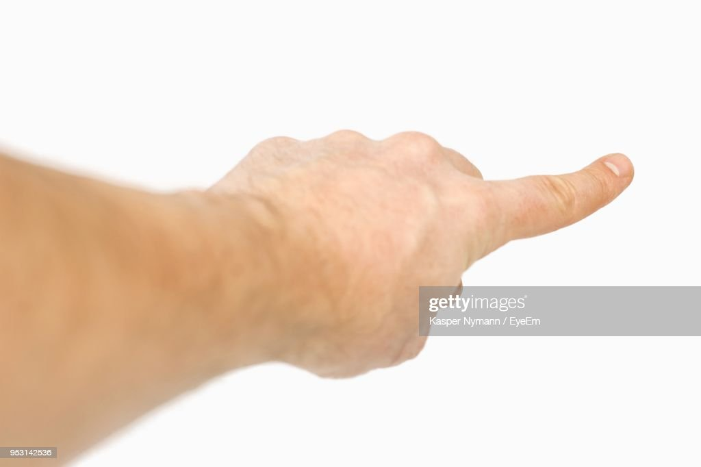 Cropped Hand Of Men Pointing Against White Background : Stock Photo