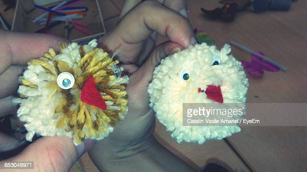 Cropped Hand Of People Holding Stuffed Toys