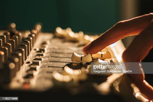 cropped hand of person adjusting sound mixer knob - equaliser stock pictures, royalty-free photos & images