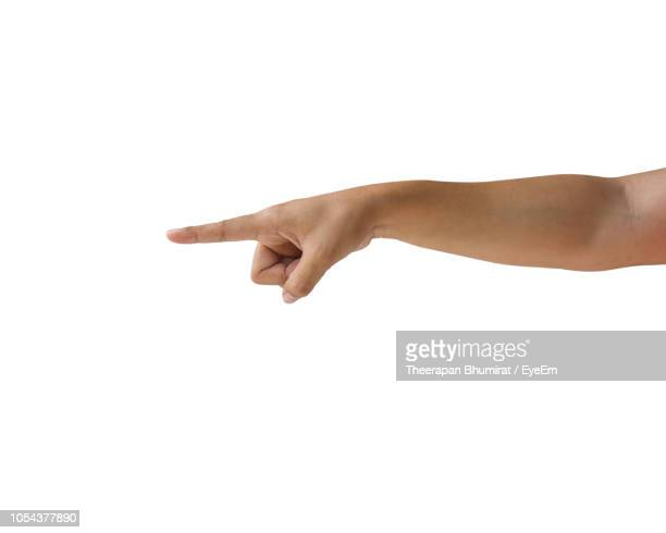 cropped hand of person gesturing against white background - dedo humano imagens e fotografias de stock