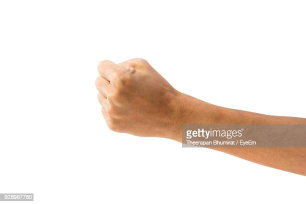 cropped hand of person gesturing against white background - 拳 ストックフォトと画像