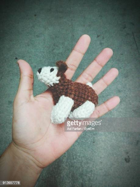 Cropped Hand Of Person Holding Knitted Animal Toy