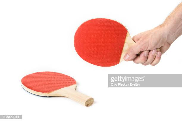 cropped hand of person holding table tennis racket - racquet stock pictures, royalty-free photos & images