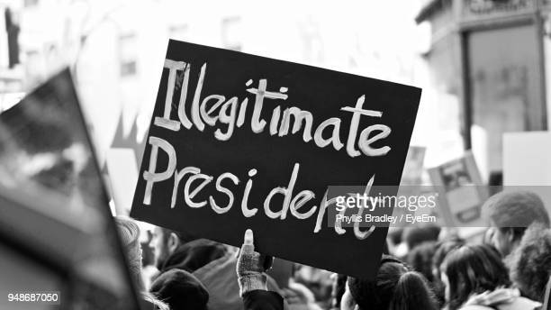 cropped hand of person holding text on blackboard - protestor stock pictures, royalty-free photos & images