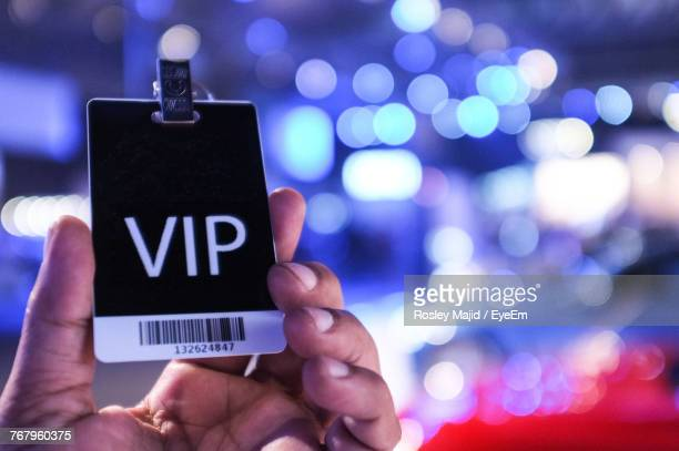 cropped hand of person holding vip text on card - beroemdheden stockfoto's en -beelden