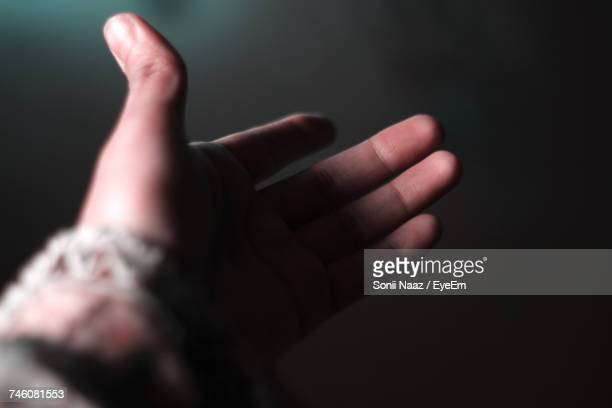 Cropped Hand Of Person In Darkroom