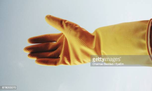 Cropped Hand Of Person In Protective Glove Against White Background