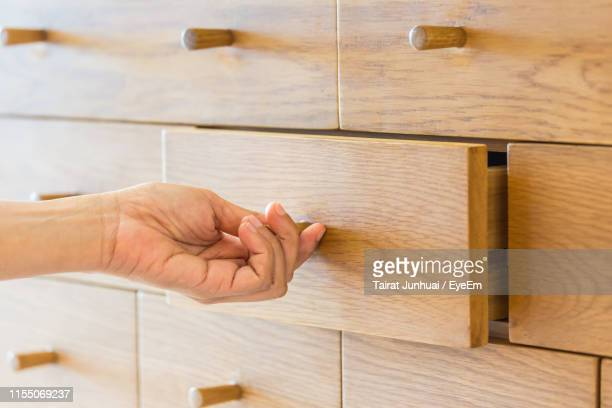 cropped hand of person opening drawer - drawer stock pictures, royalty-free photos & images