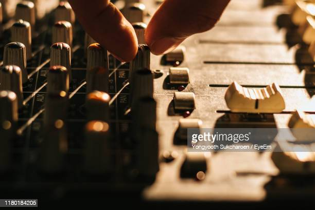 cropped hand of person operating sound mixer - equaliser stock pictures, royalty-free photos & images