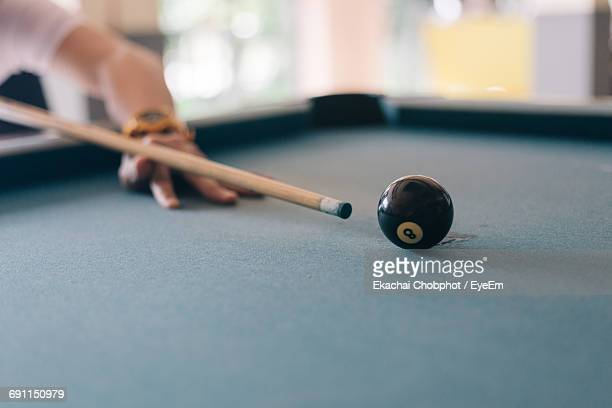 Cropped Hand Of Person Playing Snooker