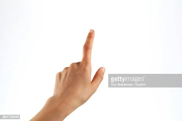 cropped hand of person pointing against white background - freisteller neutraler hintergrund stock-fotos und bilder