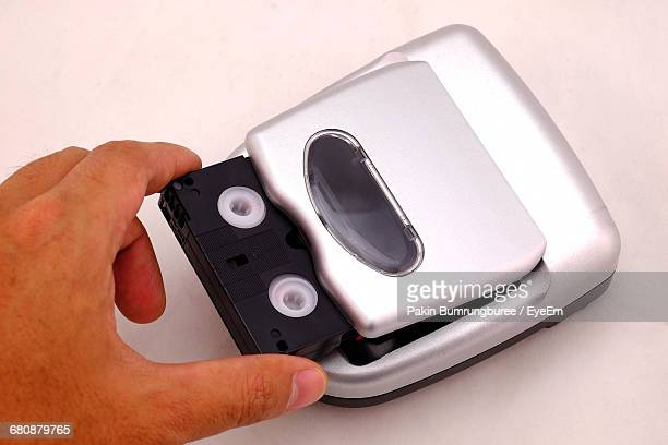Cropped Hand Of Person Putting Audio Cassette In Personal Stereo