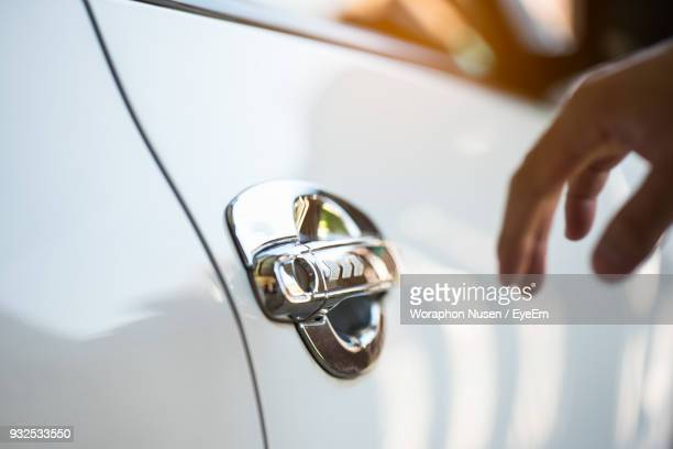 cropped hand of person reaching for car door handle - handle stock pictures, royalty-free photos & images