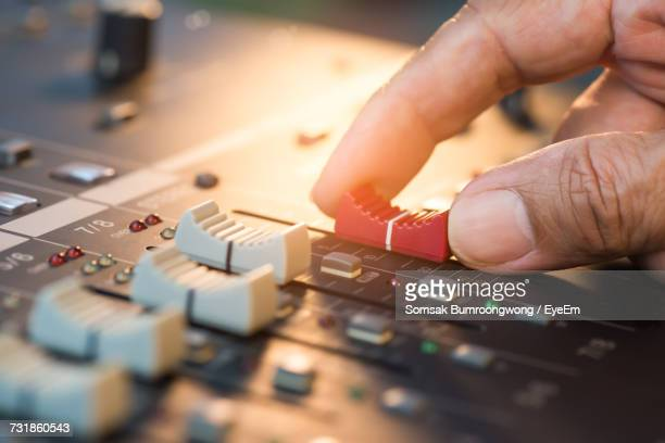 cropped hand of person using sound mixer - equaliser stock pictures, royalty-free photos & images