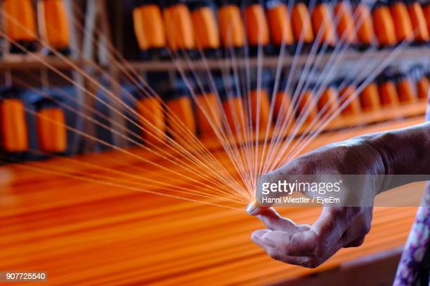 cropped hand of person weaving loom - loom stock pictures, royalty-free photos & images