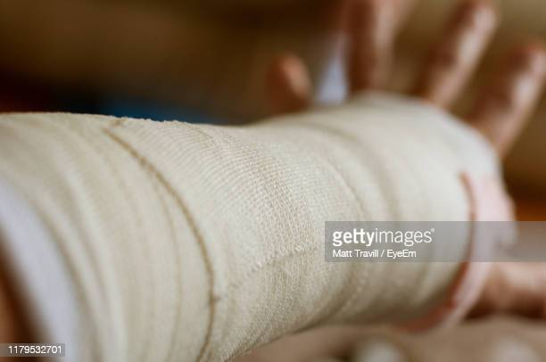 cropped hand of person with bandage - bandage stock pictures, royalty-free photos & images