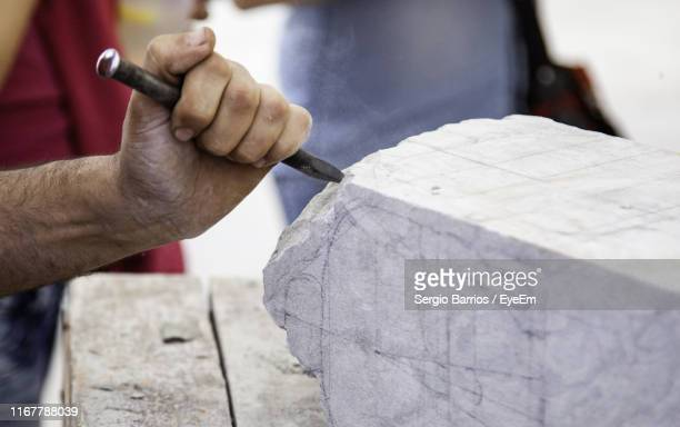 cropped hand of sculptor working - sculptor stock pictures, royalty-free photos & images