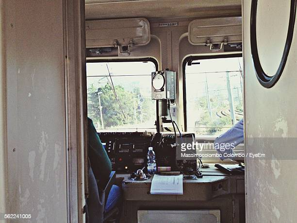 Cropped Hand Of Train Driver With Control Panel