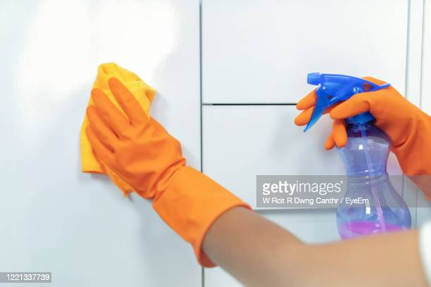 cropped hand of woman cleaning tiled wall - housework stock pictures, royalty-free photos & images