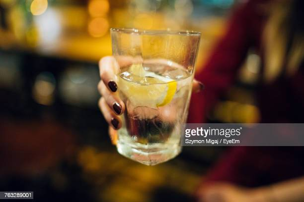 Cropped Hand Of Woman Holding Drink