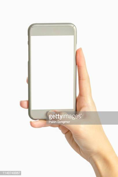 cropped hand of woman holding smart phone on white background - 人工的 ストックフォトと画像