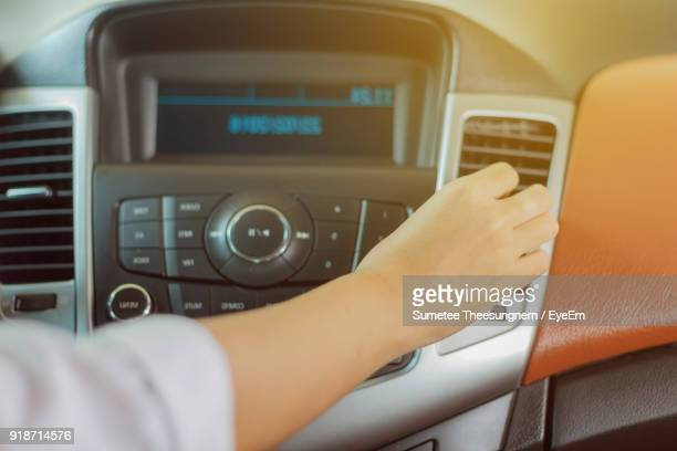 Cropped Hand Of Woman In Car