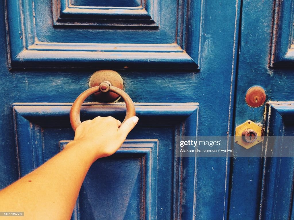 Cropped Hand Of Woman Knocking Door  Stock Photo & Cropped Hand Of Woman Knocking Door Stock Photo | Getty Images
