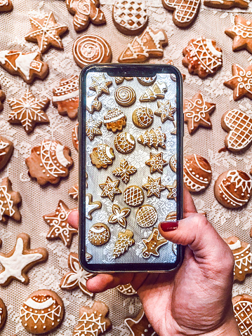 Cropped Hand Of Woman Photographing Cookies With Mobile Phone On Table - gettyimageskorea