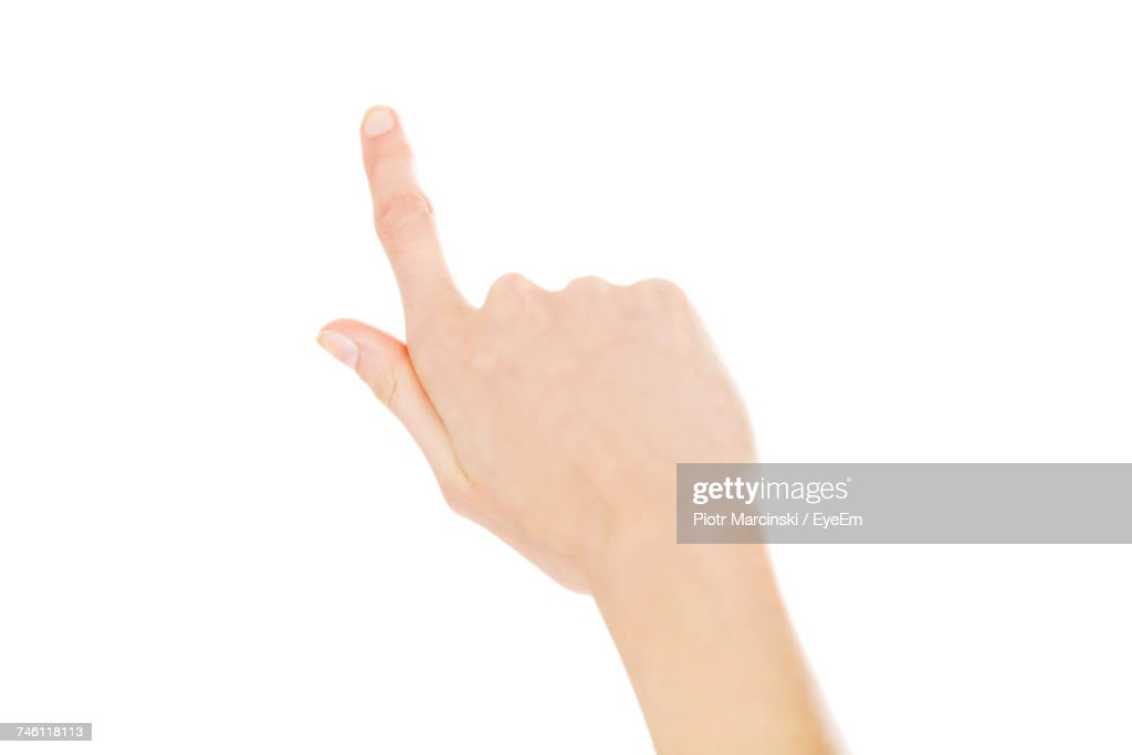 Cropped Hand Of Woman Pointing Against White Background : Stock Photo