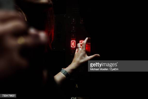 Cropped Hand Of Woman Pushing Elevator Button
