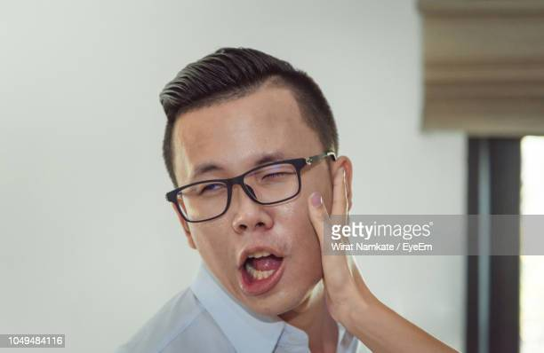 cropped hand of woman slapping on face of man - slapping stock pictures, royalty-free photos & images