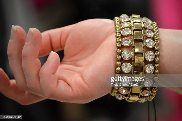 cropped hand of woman wearing bangle - bangle stock pictures, royalty-free photos & images