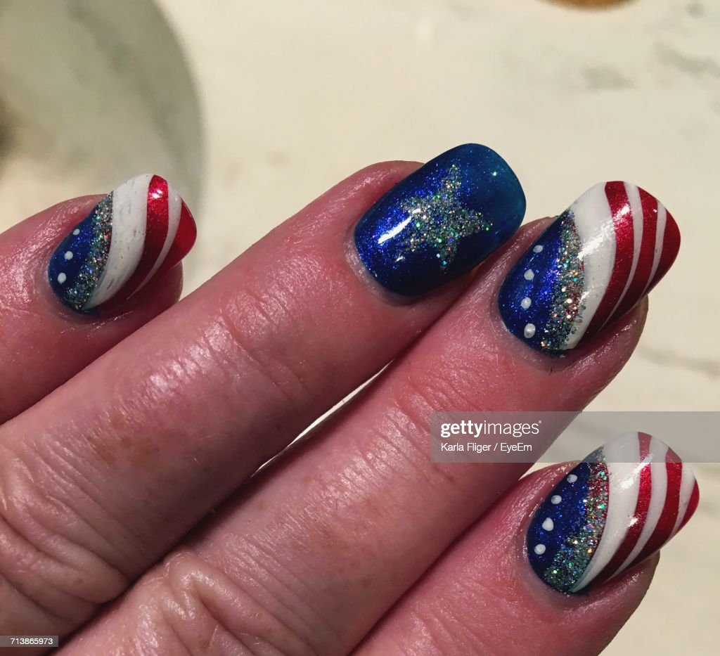 Cropped Hand Of Woman With American Flag Nail Art - Cropped Hand Of Woman With American Flag Nail Art Stock Photo