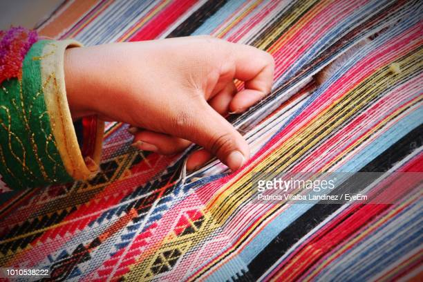 cropped hand of woman with fabric on loom - loom stock pictures, royalty-free photos & images