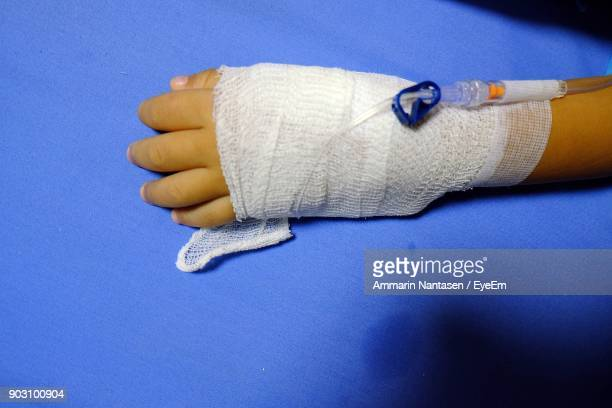 cropped hand of woman with iv drip - iv drip womans hand stock pictures, royalty-free photos & images