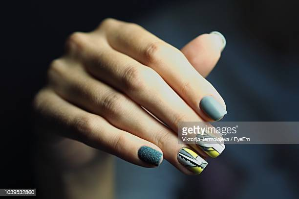 cropped hand of woman with painted fingernails - nail art stock pictures, royalty-free photos & images