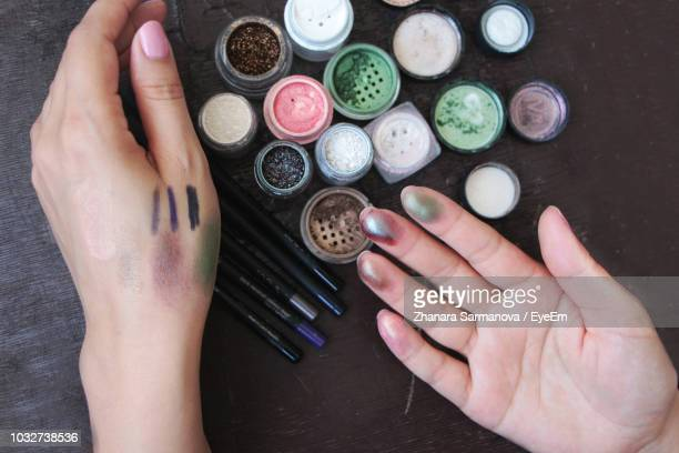 cropped hand of woman with various jars at table - eyeshadow stock pictures, royalty-free photos & images