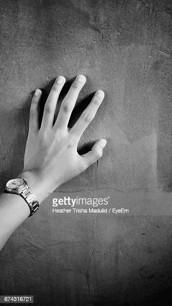 Cropped Hand On Wall